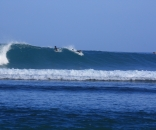 surfing in krui epic wave out front in Krui South Sumatra